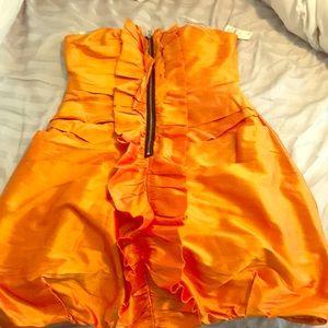 Vibrant orange dress.